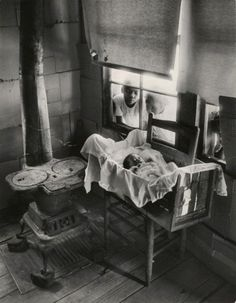 Sibling Love - W. Eugene Smith, Newborn Baby in Makeshift Crib near Cold Stove, 1951  (source, icp - AN: 991.2005)