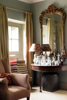 """Like the rest of the house, the comfortable drawing room is furnished with antique furniture, mirror and glass.  Like this? Then you'll love  [link url=""""http://www.houseandgarden.co.uk/interiors/furnishings/desks-and-dressing-tables""""]Do the Write Thing[/link]"""
