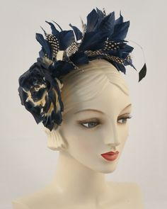 Feather whimsy with silk flower