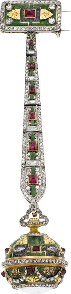 Boucheron Watch Fob Case, c. 1915: platinum and 18k gold with green enamel, raised gold leaf and garland designs, diamond set garlands, platinum and diamond center band, shield shaped and rectangular bezel set rubies, 23 mm diameter, 3 1/2 inch long platinum fob with diamonds, rubies and enamel, upper rectangular frame with double pins Art Deco
