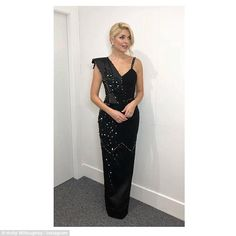 DOI: Holly Willoughby sizzles in a pearl-encrusted gown  Shes always flooring her 3.3m Instagram followers with her incredible sartorial elegance.  And Holly Willoughby didnt disappoint her legion of loyal fans as she prepared to take centre stage on ITVs Dancing on Ice On Sunday.  The 37-year-old host poured her incredible physique into a gem-encrusted black gown with a decadent sash shoulder detail.  Hot enough to melt the ice: Fans went wild for Holly Willoughbys style as she turned up…