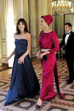 Sheikha Mozah bint Nasser Al Missned of Qatar and Carla Bruni. head wrap   turban