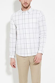 A woven long-sleeved shirt featuring an allover grid pattern with a buttoned front, a basic collar, a chest patch pocket, and a curved hem.