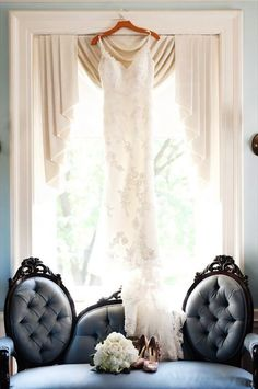 I just ADORE this shot, AND this dress. wow <3  20 Must-Have Getting Ready Photos for Your Wedding via Brit + Co.
