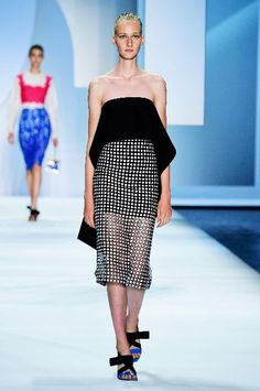 Models walk the runway wearing Monique Lhuillier Spring 2016 during New York Fashion Week: The Shows at The Arc, Skylight at Moynihan Station on September 12, 2015 in New York City.