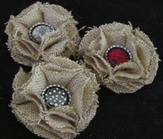 Burlap Flowers- Circles folded in half then accordion folded two times. Center button using a small paper circle glued inside a bottle top and glued into the center of the flower.