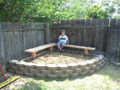 Kids' mud pit- or raised flower bed area. Benches would be easy DIY too