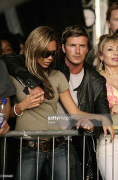 English football captain David Beckham and his wife Victoria attend 'Live 8 London' in Hyde Park on July 2, 2005 in London, England. The free concert is one of ten simultaneous international gigs including Philadelphia, Berlin, Rome, Paris, Barrie, Tokyo, Cornwall, Moscow and Johannesburg. The concerts precede the G8 summit (July 6-8) to raise awareness for MAKEpovertyHISTORY.
