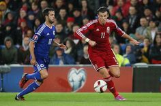 Bosnia Herzegovina's Miralem Pjanic (L) and Wales' Gareth Bale in action Transfer Rumours, Gareth Bale, Bosnia, Liverpool Fc, Wales, Soccer, Action, Football, Sports