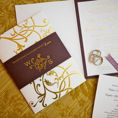 Invitations? if we go with gold, white, purple theme?