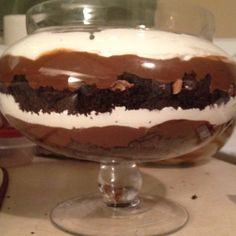 Chocolate cake, pudding, cool whip and crushed Heath bars layered in a pretty bowl.  We've done this with brownies and add berries on top and it's always a hit!