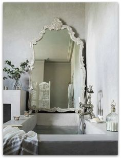 grey and white bathroom with earthy accents, large mirror