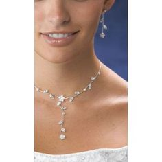 Our stunning Crystal Flower Bridal Jewelry Set will truly sparkle with your formal gown. You are sure to love this silver-tone necklace and earring set featuring clear crystals.  Necklace is adjustable from 13 to 17 inches long.  Earrings measure 1.75 inches long.  Hypo-allergenic, nickel free and electroplated silver.