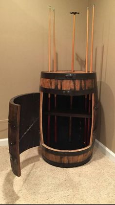 Check out this item in my Etsy shop https://www.etsy.com/listing/222435050/bourbon-whiskey-barrel-pool-cue-holder