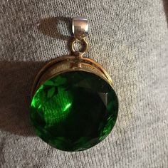 HUGE Vintage Peridot set in Sterling Silver/Gold Beautiful!!!!! This genuine huge faceted peridot handcrafted and was heat treated to enhance color. Bail is Sterling Silver, Peridot Set in Sterling with gold overlay. Stunning!!! Jewelry