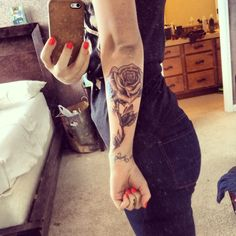 Check out this girls blog! cute clothing Ideas. Rose tattoo arm, girl tattoo,
