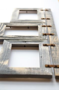 """This collage frame is made from (3) 8x10--2"""" hand crafted barnwood distressed frames connected to a barnwood header with rusty brackets. It hangs 2 8x10 rustic"""