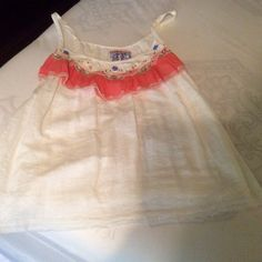 Tank top White with embellished ruffle top, ribbon tie around.  Raw edge around bottom.  Linen and cotton. Free People Tops Tank Tops