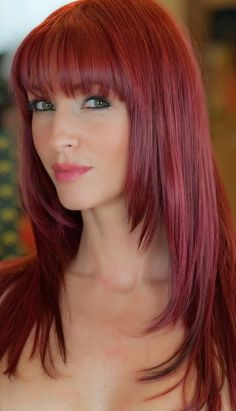 long straight bangs, fringe with layers. red hair.