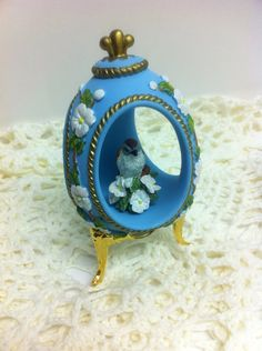 Collectible porcelain egg with bird inside with by LoreNovedades, $18.50