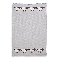 This adorable blanket will keep your baby warm and cozy. It features a grey lattice pattern with a border of little lambs. Measures 30 x 40.