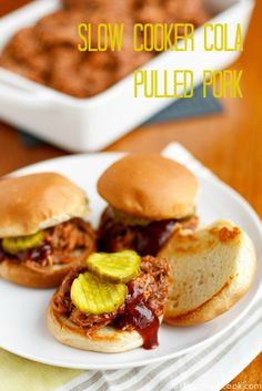 Slow Cooker Pulled Pork Recipe -- slow cooking a bone-in pork shoulder in your favorite cola beverage is the key to this tender and flavorful pulled pork!
