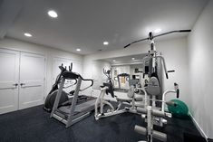 """a home gym, complete with a springy rubber floor. """"We now have an at-home gym that I can work out in every morning,"""" Powell says. The family is glad every day that they decided to go all-out. They love their basement and use it all the time."""