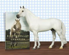 This special set combines the #Breyer portrait model of Snowman with the newly released paperback edition of Elizabeth Letts' best-selling novel The Eighty-Dollar Champion. #Horses #BreyerModelHorses
