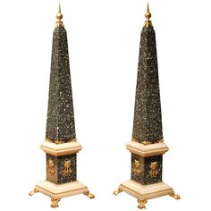 Rome, Empire period An outstanding pair of green Porphyry and Carrara marble obelisks with finely carved mercury gilt bronze details. The square shaped base rests on gilt bronze lion's paw feet