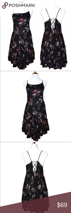 Free People Corset Asymmetrical Floral Black Dress Free People floral slip dress. Black with light red and light purple floral print, spaghetti straps, adjustable corset ties in back with very flowy tiered gypsy V hemline skirting. Wear this year round with a cardigan sweater and boots on cool days or by itself on warm days, this is a beautiful classic must have go-to piece for every closet. Very good condition. ❤️ Free People Dresses Midi
