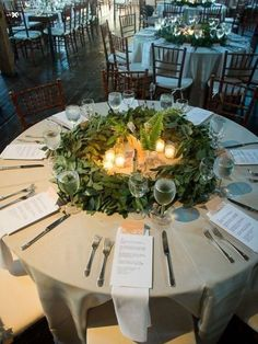Like the idea of using greenery wreath to contain centerpiece Tablecloth