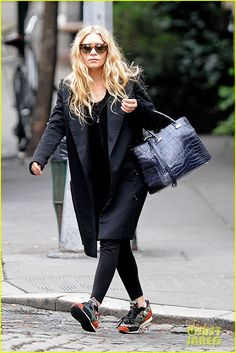 Ashley Olsen Black trench with converse