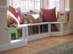 Angled bench seating in the Dining room creates a unique alcove. Neat idea with bookshelves beneath seat.