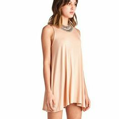 ⭐NEW! Chic Nude Swing Mini Dress Contemporary Style   Swing Mini Dress Nude  96% Polyester  4% Spandex  High Quality (not see through) Boutique  Made in U.S.A  True To Size  NWOT Directly From Vendor  *Necklace not included   ▪ Price is Firm ▪ No Trades  ▪ Fast Shipping IT Ragazza  Dresses Mini
