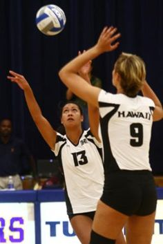 University of Hawaii Rainbow Wahine Mita Uiato (13) sets the ball for Jade Vorster (9) during a game on Saturday at Crawford Hall.