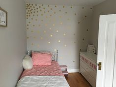 Gold Vinyl dot accent wall helps to add a simple little sparkle to a little girl's room. A little detail goes a long way in a small space.
