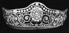 Princess Mary, only daughter of Mary and George, (Later  King George V and Queen Mary), married Henry, Viscount Lascelles, (Later 6th Earl of Harewood) on 28th February, 1922. Not quite the tiara magnet that her mother was but Mary Harewood did wear some nice pieces. This is her scroll tiara; featuring six diamond clusters, linked by scrolls and ribbons of diamonds, with stylised heart motifs.