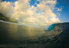 Serenity Now -- Sun, water, wave, surf. Oh and a rainbow. This gorgeous photograph by Zak Noyle was the winner of Surfer Magazine's 'photo of the year' and it's easy to see why. The image was taken with a fisheye lens at Teahupoo in Tahiti. The surfer is Christian Redongo.
