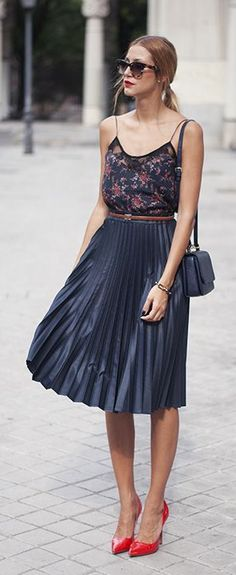 Print Top, Pleated Skirt and Red Heels.