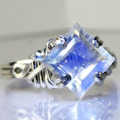 Princess Cut Rainbow Moonstone Ring Polished by PassionateJewelry, $44.00   Huh. I don't believe I've ever encountered a princess-cut moonstone before.