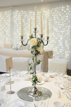 Wedding Table Candelabra Centerpiece - While looking for the most memorable wedding dining ideas, you should keep four thi Candleabra Wedding Centerpieces, Candelabra Flowers, Candlestick Centerpiece, Wedding Table Centerpieces, Table Flowers, Flower Centerpieces, Wedding Decorations, Wedding Candelabra, Wedding Centerpieces