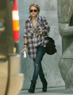 An Olsen rocking a grunge inspired look love the oversized shirt and necklaces x