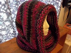 A nice simple bulky cowl in stock knit. Knit with two strands of Loops and Threads Charisma in Black Raspberry (two skeins) on size 15 needles. One size.