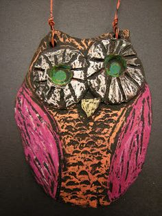 Clay Owls... colored with oil pastel and black tempera paint, which means no need for glaze!