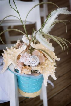 Use shells and starfish in a pail or colorful beach bucket as your beach wedding ceremony decor! For more ideas see:  http://www.beachwedding-guide.com/beach-wedding-ceremony-decor.html