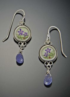 Violet Earrings with Tanzanite drop by Ananda Khalsa Jewelry.  Each painting is done by hand, and set behind glass in a bezel of sterling silver.  No two are the same.