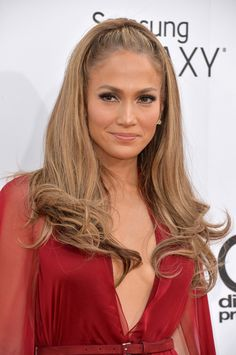 JLO went for a half up ponytail and her classic bronzed beauty look