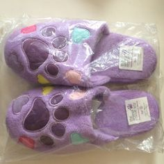 House slippers with paws and hearts Brand new in packaging. Purple paw and hearts slippers for indoors. Super cute! Size S, which means it fits anyone who wears a 5.5-7 shoe. Shoes Slippers