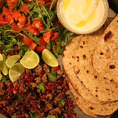 Spicy Lamb Flatbreads with Yoghurt & Pomegranate by Georgina O'Sullivan. | A 'dig in and help yourself' supper, great for sharing - bringing the sensational flavours of Northern Africa to your home.
