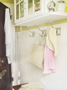 Hooked on Storage.  For a bathroom used by multiple people, nix the towel bars in favor of hooks. By using hooks, you can give each person a designated spot for a towel, rather than compete for limited space on a towel bar.